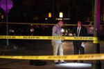 In this Wednesday, Sept. 18, 2019 photo, investigators work the scene of a homicide in St. Paul, Minn. (Renee Jones Schneider/Star Tribune via AP)