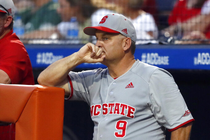 FILE - In this May 25, 2019, file photo, North Carolina State coach Elliott Avent watches during the late innings of an NCAA college baseball game against Georgia Tech in the semifinals of the Atlantic Coast Conference tournament in Durham, N.C. Avent's Wolfpack overcame a 1-8 start in ACC play to return to the College World Series for the first time since 2013. (Ethan Hyman/The News & Observer via AP)