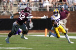 LSU wide receiver Trey Palmer (33) runs past Mississippi State lineman Grant Jackson (52) for a yardage gain during the first half of an NCAA college football game, Saturday, Sept. 25, 2021, in Starkville, Miss. (AP Photo/Rogelio V. Solis)