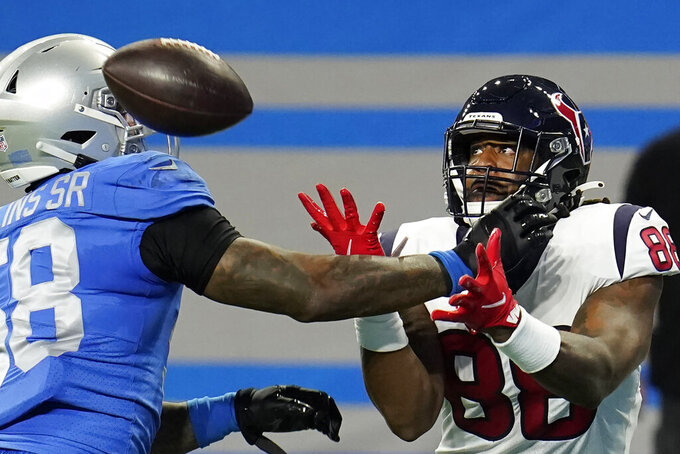 Houston Texans tight end Jordan Akins (88), defended by Detroit Lions outside linebacker Jamie Collins (58), is unable to make the catch during the first half of an NFL football game, Thursday, Nov. 26, 2020, in Detroit. (AP Photo/Paul Sancya)