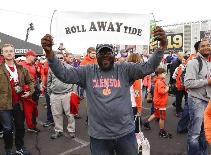 Fans gather outside Levi's Stadium before the NCAA college football playoff championship game between Alabama and Clemson Monday, Jan. 7, 2019, in Santa Clara, Calif. (AP Photo/David J. Phillip)