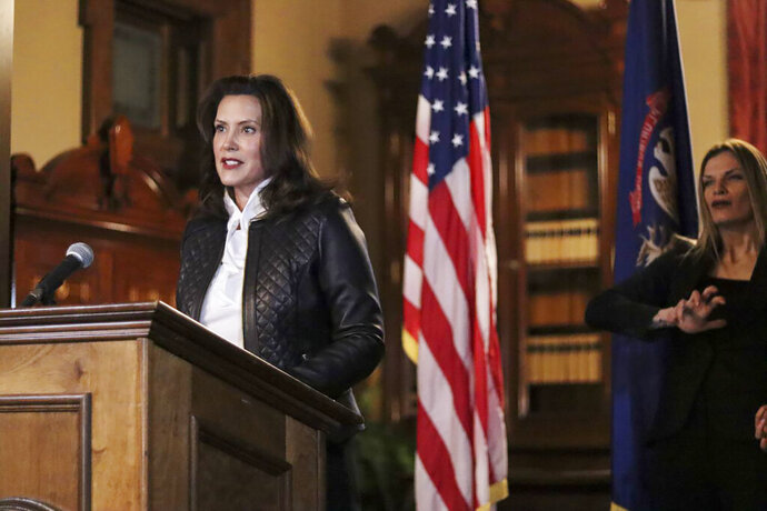 FILE - In an Oct. 8, 2020 file photo provided by the Michigan Office of the Governor, Michigan Gov. Gretchen Whitmer addresses the state during a speech in Lansing, Mich. The governor delivered remarks addressing Michiganders after the Michigan Attorney General, Michigan State Police, U.S. Department of Justice, and FBI announced state and federal charges against 13 members of two militia groups who were preparing to kidnap and possibly kill the governor. (Michigan Office of the Governor via AP File)