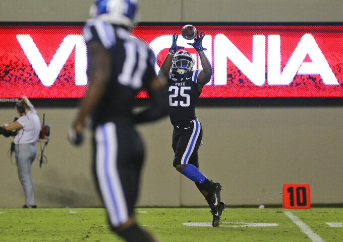 Duke's Deon Jackson (25) catches a 25-yard touchdown pass in the second quarter of an NCAA college football game against Virginia Tech, Friday, Sept. 27, 2019, in Blacksburg, Va. (Matt Gentry/The Roanoke Times via AP)