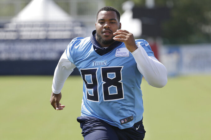 FILE- In this July 29, 2019, file photo, Tennessee Titans defensive lineman and top draft pick Jeffery Simmons runs during NFL football training camp in Nashville, Tenn. The defensive tackle out of Mississippi State tore his ACL in February but has begun practicing with the Titans even as he remains on the non-football injury list. The Titans are using the workouts to see if he is recovered enough to play, possibly against the Los Angeles Chargers on Sunday. (AP Photo/Mark Humphrey)