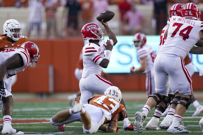 Louisiana-Lafayette quarterback Levi Lewis (1) is pressured by Texas safety Zach Edwards (43) during the second half of an NCAA college football game Saturday, Sept. 4, 2021, in Austin, Texas. (AP Photo/Eric Gay)