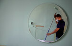 Hotel maintenance worker Elgis Moreno is reflected on a mirror as he paints a room at the Capri Hotel, during a lockdown affecting tourism to curb the spread of the new coronavirus in Havana, Cuba, Wednesday, June 17, 2020. Foreign hospitality companies that manage most of the better hotels say they are hopeful to see tourists return at the latter stages of the country's opening plan, and Cuba says more normal tourism will return to the island by phase 3 with near-universal mask-wearing, social distancing, and COVID-19 tests for arriving travelers. (AP Photo/Ismael Francisco)