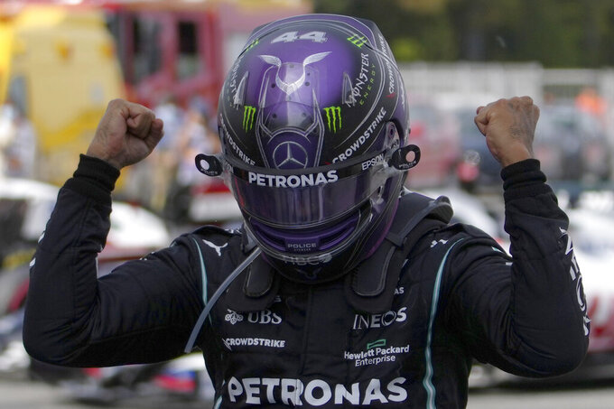 Mercedes driver Lewis Hamilton of Britain celebrates after winning the Spanish Formula One Grand Prix at the Barcelona Catalunya racetrack in Montmelo, just outside Barcelona, Spain, Sunday, May 9, 2021. (AP Photo/Emilio Morenatti, Pool)