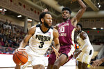 Purdue guard Jahaad Proctor (3) drives the baseline against Florida State forward Malik Osborne (10) in the first half of an NCAA college basketball game at the Emerald Coast Classic in Niceville, Fla., Saturday, Nov. 30, 2019. (AP Photo/Mark Wallheiser)