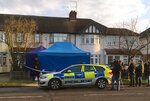 Media observe as British police cordon off a house in southwest London, Tuesday March 13, 2018, after an unexplained death at the residential address of a Russian businessman associated with a prominent critic of the Kremlin. Police confirmed they are treating the death as unexplained and have put counterterrorism detectives in charge of the case. (AP Photo / Eva Ryan)