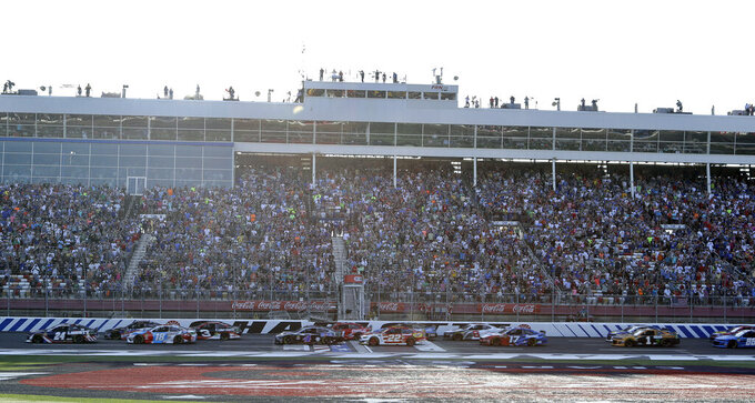 William Byron (24) leads the field at the start of a NASCAR Cup Series auto race at Charlotte Motor Speedway in Concord, N.C., Sunday, May 26, 2019. (AP Photo/Chuck Burton)