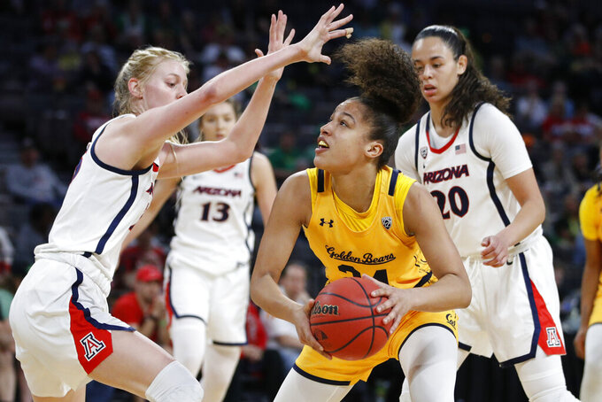 FILE - In this Friday, March 6, 2020, file photo, California's Evelien Lutje Schipholt (24) shoots against Arizona's Cate Reese, left, during the first half of an NCAA college basketball game in the quarterfinal round of the Pac-12 women's tournament in Las Vegas. The coronavirus pandemic has created problems greater than the inability to compete for the more than 20,000 foreign college athletes in the United States. Many are struggling with a decision about whether to stay in this country or return home. Schipholt, from The Netherlands, is staying with teammate Cailyn Crocker and her family in Southern California. (AP Photo/John Locher, File)