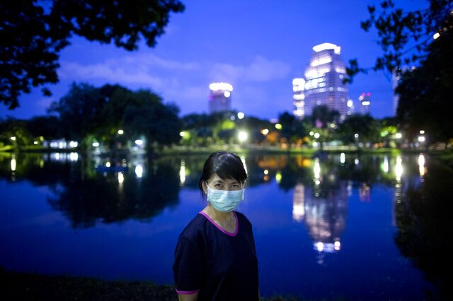 Nantaga Sanguannoi poses for photo during her evening walk at Lumpini park Bangkok, Thailand on Tuesday, July 21, 2020. Sanguannoi, works as a registered nurse in a hospital in Bangkok.