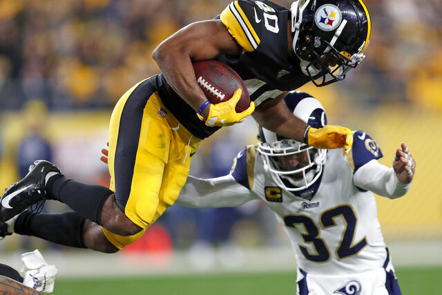 """FILE - In this Nov. 10, 2019, file photo, Los Angeles Rams free safety Eric Weddle (32) tackles Pittsburgh Steelers running back Tony Brooks-James during the second half of an NFL football game in Pittsburgh. The Rams' veteran safety spent the previous three seasons with the Baltimore Ravens, but he is declining to give any inside information about his former team to the Rams ahead of the Ravens' visit to the Coliseum on Monday night. """"I could tell them a lot of stuff,"""" Weddle said Wednesday, Nov. 20. """"But that's just not who I am."""" (AP Photo/Keith Srakocic, File)"""