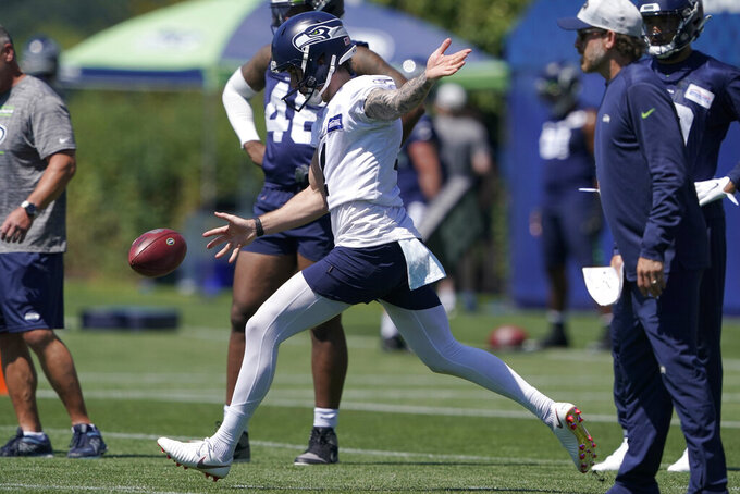 Seattle Seahawks punter Michael Dickson kicks during NFL football practice Thursday, July 29, 2021, in Renton, Wash. (AP Photo/Ted S. Warren)
