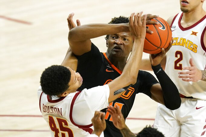 Oklahoma State forward Matthew-Alexander Moncrieffe shoots over Iowa State guard Rasir Bolton (45) during the second half of an NCAA college basketball game, Monday, Jan. 25, 2021, in Ames, Iowa. Oklahoma State won 81-60. (AP Photo/Charlie Neibergall)