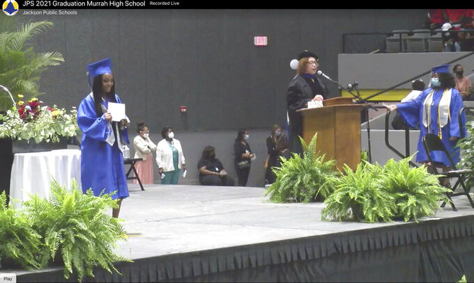 DIFFERENT CROP- This frame grab from video provided by Jackson Public School District shows Kennedy Hobbs, left. The 18-year-old Hobbs was shot three times at a Texaco gas station in Jackson, Miss., just hours after her graduation from Murrah High School. She died at the scene just before 11 p.m., Jackson Police Department spokesman Sam Brown said. (Jackson Public School District via AP)