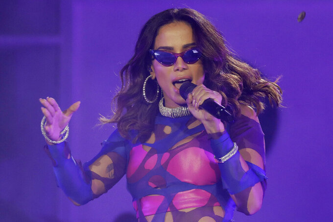 """FILE - In this Oct. 5, 2019 file photo, Brazilian singer Anitta performs at the Rock in Rio music festival in Rio de Janeiro, Brazil. Anitta's spin on the classic """"TheGirl from Ipanema"""" Bossa Nova song provides a new vision of women in Rio de Janeiro with lyrics that convey reality: that the city's women have fuller figures than the tall and tan one from the 1960s original by Antônio Carlos Jobim and Vinicius de Moraes. (AP Photo/Leo Correa, File)"""