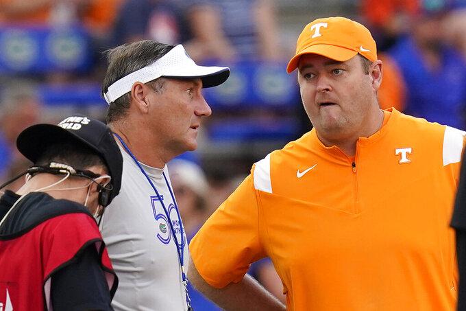 Florida head coach Dan Mullen, left, and Tennessee head coach Josh Heupel greet each other before an NCAA college football game, Saturday, Sept. 25, 2021, in Gainesville, Fla. (AP Photo/John Raoux)