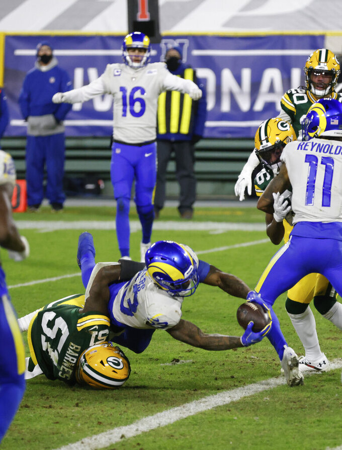 Los Angeles Rams' Cam Akers (23) scores on a seven-yard touchdown run during the second half of an NFL divisional playoff football game Saturday, Jan. 16, 2021, in Green Bay, Wis. (AP Photo/Matt Ludtke)
