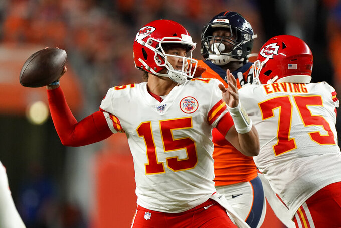Kansas City Chiefs quarterback Patrick Mahomes (15) throws against the Denver Broncos during the first half of an NFL football game, Thursday, Oct. 17, 2019, in Denver. (AP Photo/Jack Dempsey)