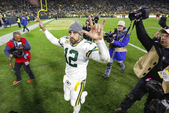 Green Bay Packers quarterback Aaron Rodgers celebrates as he walks off the field following an NFL football game against the Detroit Lions, Monday, Oct. 14, 2019, in Green Bay, Wis. Green Bay won 23-22. (AP Photo/Mike Roemer)