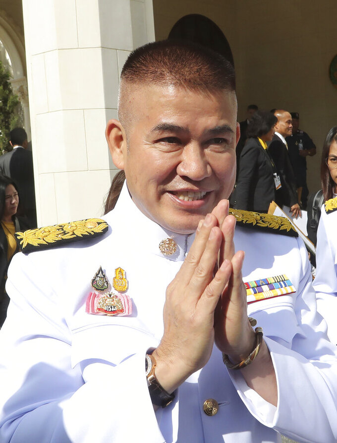 FILE - In this Tuesday, July 16, 2019, file photo, Deputy Agriculture Minister Thammanat Prompao arrive for a group photo with his cabinet members at the government house in Bangkok, Thailand. A Thai court ruled on Wednesday that Thammanat could keep his ministerial post and continue as a lawmaker, even though he was convicted and jailed in Australia in 1994 for smuggling heroin. (AP Photo/Sakchai Lalit, File)