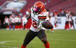 FILE - In this Aug. 23, 2019, file photo, Cleveland Browns' Braxton Miller (12) is shown before an NFL preseason football game against the Tampa Bay Buccaneers, in Tampa, Fla. The Browns don't have many roster spots up for grabs, but depth at wide receiver is suddenly an issue following Antonio Callaway's drug suspension and Jaelen Strong's release. Former Ohio State quarterback Braxton Miller is expected to get a long look at receiver and perhaps as punt returner. (AP Photo/Mark LoMoglio, File)