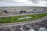 Drivers pass the front stretch at the start of a NASCAR Xfinity series auto race at Daytona International Speedway, Saturday, Feb. 15, 2020, in Daytona Beach, Fla. (AP Photo/Phelan M. Ebenhack)