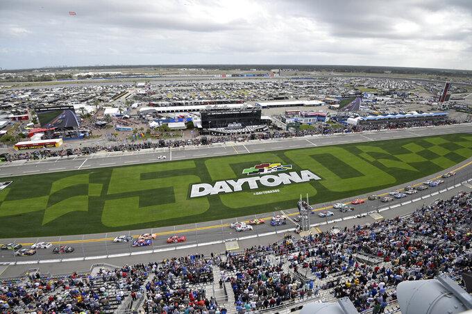 Drivers pass the front stretch at the start of a NASCAR Xfinity series auto race at Daytona International Speedway, Saturday, Feb. 15, 2020, in Daytona Beach, Fla. (AP Photo/Phelan M. Ebenhack)
