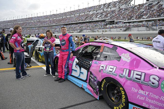 Driver Garrett Smithley (53) stands next to his car on pit road before a NASCAR Cup Series auto race at Daytona International Speedway, Saturday, Aug. 28, 2021, in Daytona Beach, Fla. (AP Photo/Phelan M. Ebenhack)