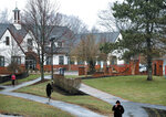 In this April 6, 2018 photo, students walk past Holbrook Hall on the campus of Mount Ida College in Newton, Mass. The state attorney general's office said Tuesday, May 15 that the sale of the college to the University of Massachusetts-Amherst can proceed because UMass paid fair market value for the smaller school, and the only alternative was the bankruptcy and closure of Mount Ida. (Craig F. Walker/The Boston Globe via AP)