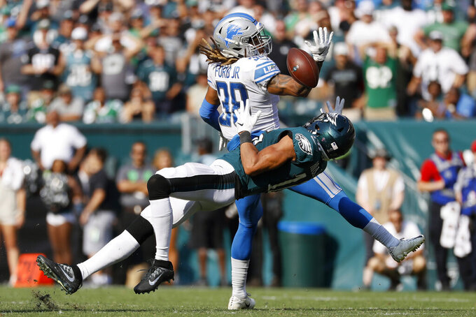 Philadelphia Eagles' Mack Hollins (16) cannot catch a pass against Detroit Lions' Mike Ford (38) during the second half of an NFL football game, Sunday, Sept. 22, 2019, in Philadelphia. (AP Photo/Michael Perez)