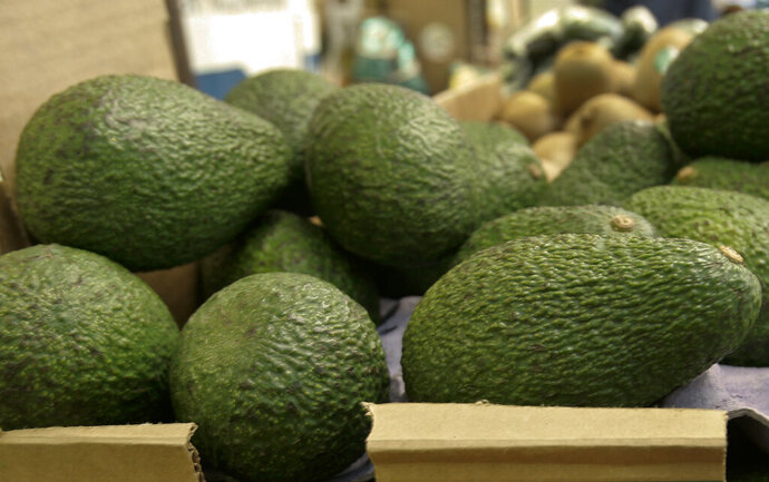 In this Jan. 17, 2007 file photo, California-grown avocados are for sale at a market in Mountain View, Calif. Henry Avocado, a grower and distributor based near San Diego, said Saturday, March 23, 2019, they are voluntarily recalling their California grown