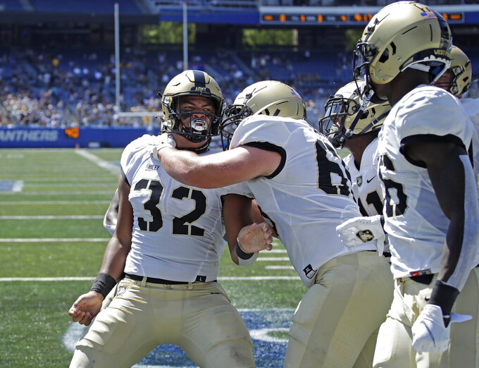 Army running back Tyson Riley (32) celebrates with Noah Knapp (65) after scoring a touchdown against Georgia State during the first quarter of an NCAA football game Saturday, Sept. 4, 2021, in Atlanta. (AP Photo/Ben Margot)