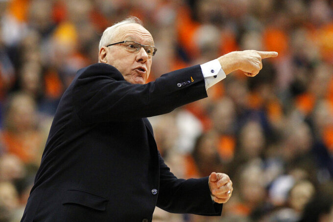 FILE - In this Feb. 23, 2019, file photo, Syracuse head coach Jim Boeheim directs his players during the first half of an NCAA college basketball game against Duke in Syracuse, N.Y. Boeheim has five freshmen on the roster as he prepares for his 44th. (AP Photo/Nick Lisi, File)