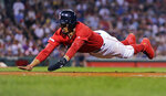 Boston Red Sox's Mookie Betts dives back to first safely on a pickoff attempt during the sixth inning of the team's baseball game against the Philadelphia Phillies at Fenway Park in Boston, Tuesday, Aug. 20, 2019. (AP Photo/Charles Krupa)