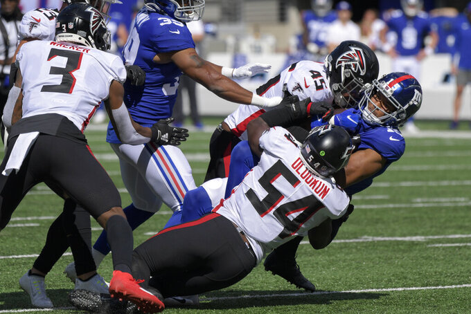 New York Giants wide receiver Collin Johnson (15) is tackled by Atlanta Falcons linebacker Deion Jones (45) and linebacker Foye Oluokun (54) during the first half of an NFL football game, Sunday, Sept. 26, 2021, in East Rutherford, N.J. (AP Photo/Bill Kostroun)