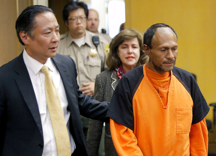 FILE - In this July 7, 2015 file photo, Jose Ines Garcia Zarate, right, is led into the courtroom by San Francisco Public Defender Jeff Adachi, left, and Assistant District Attorney Diana Garciaor, center, for his arraignment at the Hall of Justice in San Francisco. Zarate, acquitted of murder in a San Francisco case that prompted immigration debate has pleaded not guilty to federal gun charges. (Michael Macor/San Francisco Chronicle via AP, Pool, File)