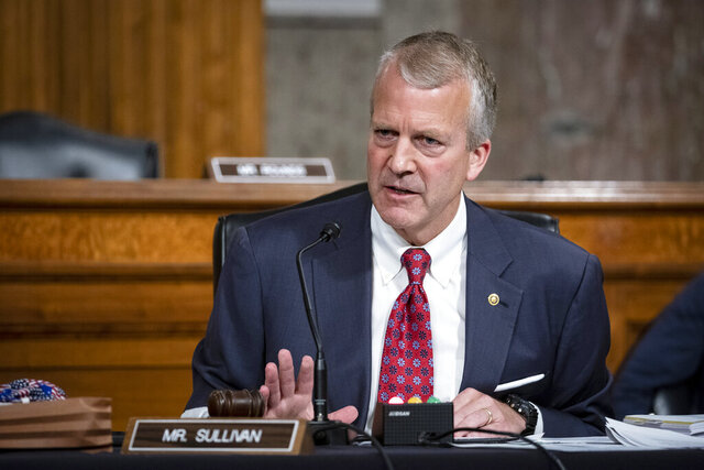 FILE - In this May 7, 2020, file photo, Sen. Dan Sullivan, R-Alaska, testifies during a hearing on Capitol Hill in Washington. Republican U.S. Sen. Dan Sullivan on Wednesday, Nov. 11, 2020, won re-election in Alaska, defeating independent Al Gross. (Al Drago/Pool via AP, File)
