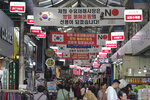 Banners calling for a boycott of Japanese products are displayed inside the Suyu market in Seoul, South Korea, Tuesday, Nov. 5, 2019. South Korean President Moon Jae-in and Japanese Prime Minister Shinzo Abe met one-on-one Monday for the first time in more than a year and called for more dialogue between the countries to settle a deep dispute over trade and history. The sign reads: