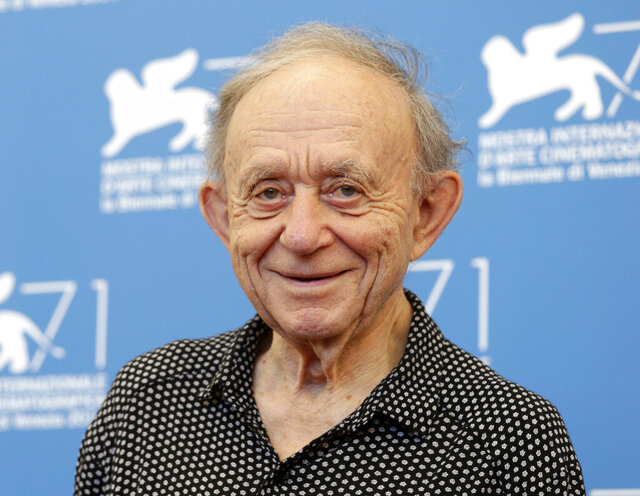 "FILE - In this Aug. 29, 2014, file photo, Frederick Wiseman poses for photographers during the photo call for the Golden Lion Career Award during the 71st edition of the Venice Film Festival in Venice, Italy. Wiseman has spent more than half a century documenting American institutions. His latest is a profile of American government. In ""City Hall"" Wiseman has turned his camera on the Boston city government. After drawing acclaim at the major fall film festivals, it opens in late October. (AP Photo/David Azia, File)"