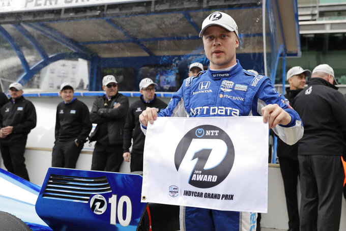 Felix Rosenqvist, of Sweden, celebrates after winning the pole for the Indy GP IndyCar auto race at Indianapolis Motor Speedway, Friday, May 10, 2019 in Indianapolis. (AP Photo/Darron Cummings)