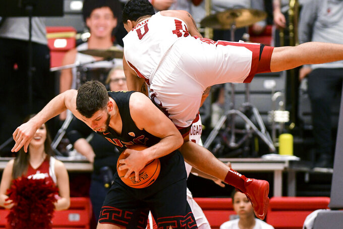 Washington State forward Isaiah Wade (0) fouls Southern California forward Nick Rakocevic during the second half of an NCAA college basketball game Saturday, Feb. 2, 2019, in Pullman, Wash. (Pete Caster/Lewiston Tribune via AP)