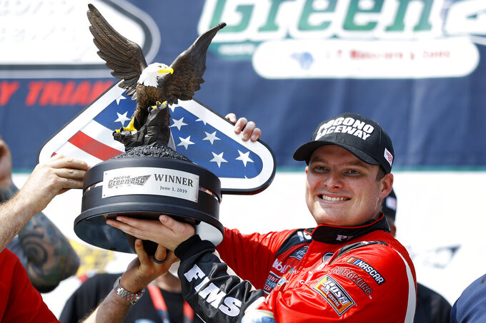 Cole Custer poses with the trophy in Victory Lane after winning the NASCAR Xfinity Series auto race at Pocono Raceway, Saturday, June 1, 2019, in Long Pond, Pa. (AP Photo/Matt Slocum)