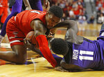 Texas Tech's Deshawn Corprew (3) and TCU's Lat Mayen (11) fight for control of the ball during the first half of an NCAA college basketball game Monday, Jan. 28, 2019, in Lubbock, Texas. (AP Photo/Brad Tollefson)