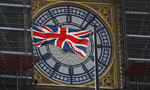 The Union flag of Great Britain and Northern Ireland flies in front of the clock face of the Queen Elizabeth Tower, that holds the bell known as 'Big Ben
