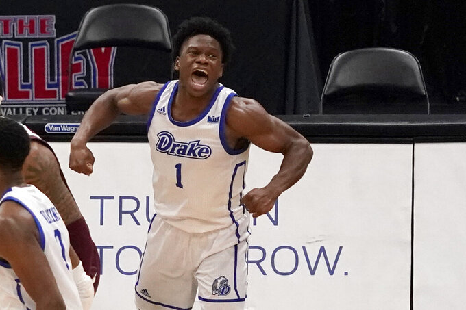 Drake's Joseph Yesufu (1) celebrates after making a last-second shot to defeat Missouri State in an NCAA college basketball game in the semifinal round of the Missouri Valley Conference men's tournament Saturday, March 6, 2021, in St. Louis. Drake won 71-69. (AP Photo/Jeff Roberson)