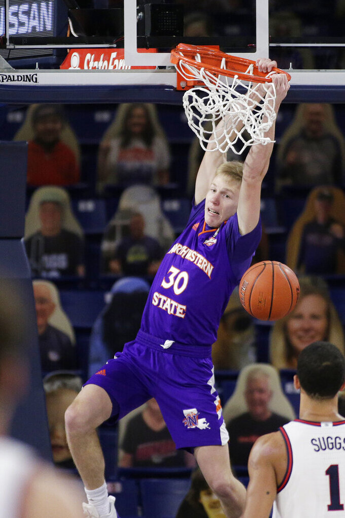 Northwestern State guard Trenton Massner (30) dunks during the first half of an NCAA college basketball game against Gonzaga in Spokane, Wash., Monday, Dec. 21, 2020. (AP Photo/Young Kwak)