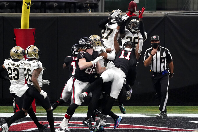 Atlanta Falcons wide receiver Julio Jones (11) misses a catch in the end zone on the last play of the game against the New Orleans Saints during the second half of an NFL football game, Sunday, Dec. 6, 2020, in Atlanta. The New Orleans Saints won 21-16. (AP Photo/John Bazemore)