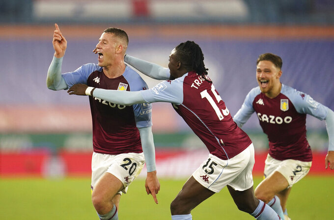 Aston Villa's Ross Barkley, left, celebrates after scoring during the English Premier League soccer match between Leicester City and Aston Villa at the King Power Stadium in Leicester, England, Sunday, Oct. 18, 2020. (Jon Super, Pool via AP)